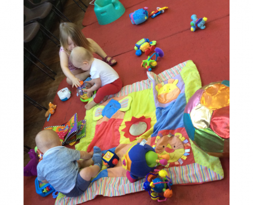 Photo showing toddlers playing at Pram and Buggy club Heswall Methodist Church